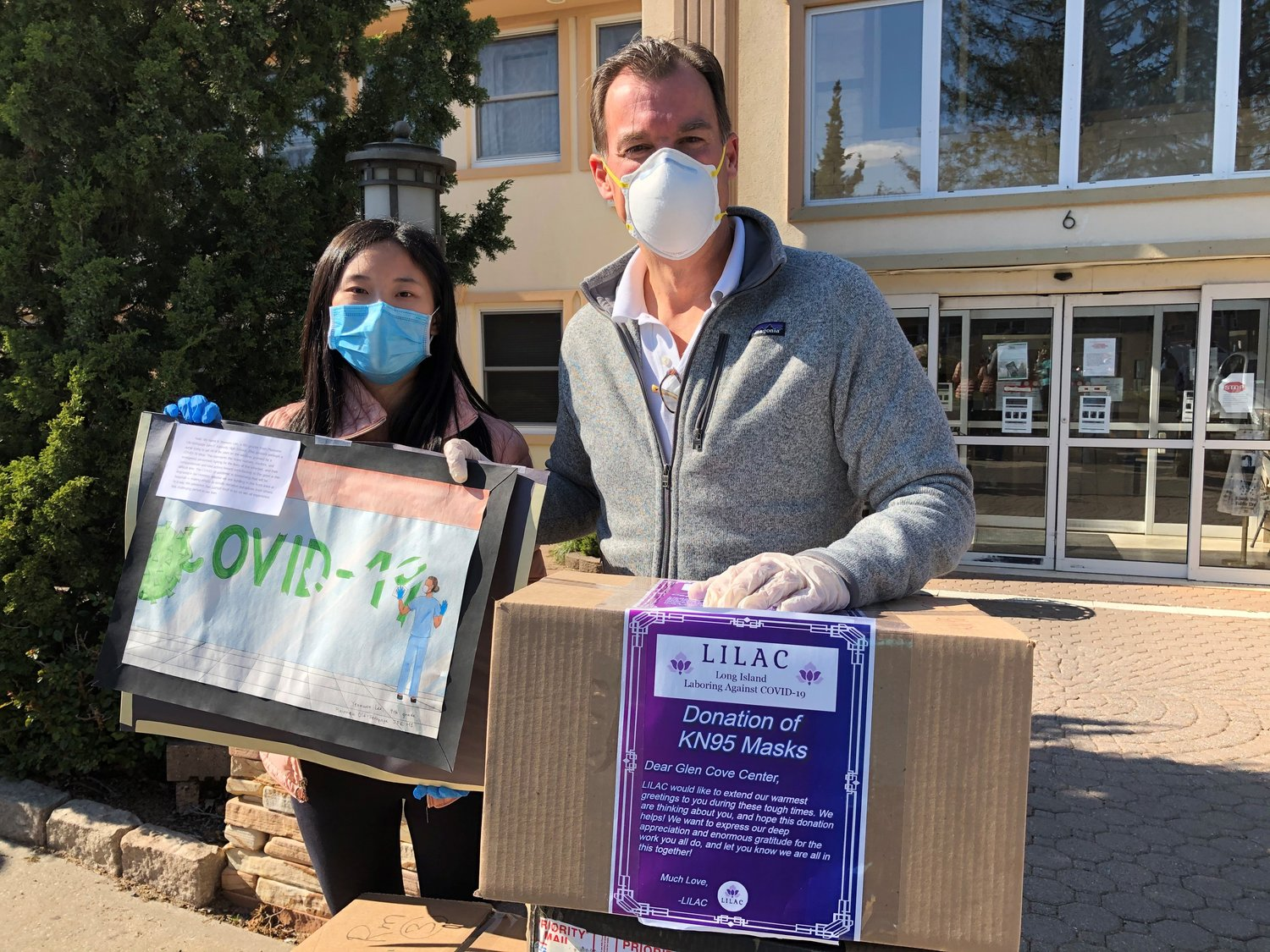 Syosset High School student Sabrina Guo, left, and Congressman Tom Suozzi take part in a donation of 1,000 PPE.