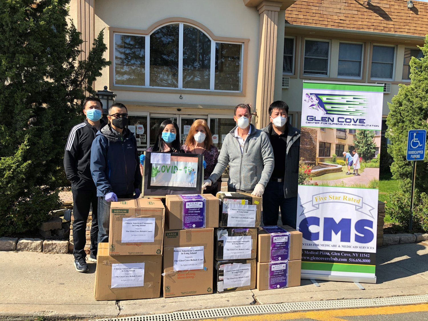 Congressman Tom Suozzi, high school student Sabrina Guo and members of the Long Island Chinese American Association provided aid to Glen Cove Center for Nursing and Rehabilitation.