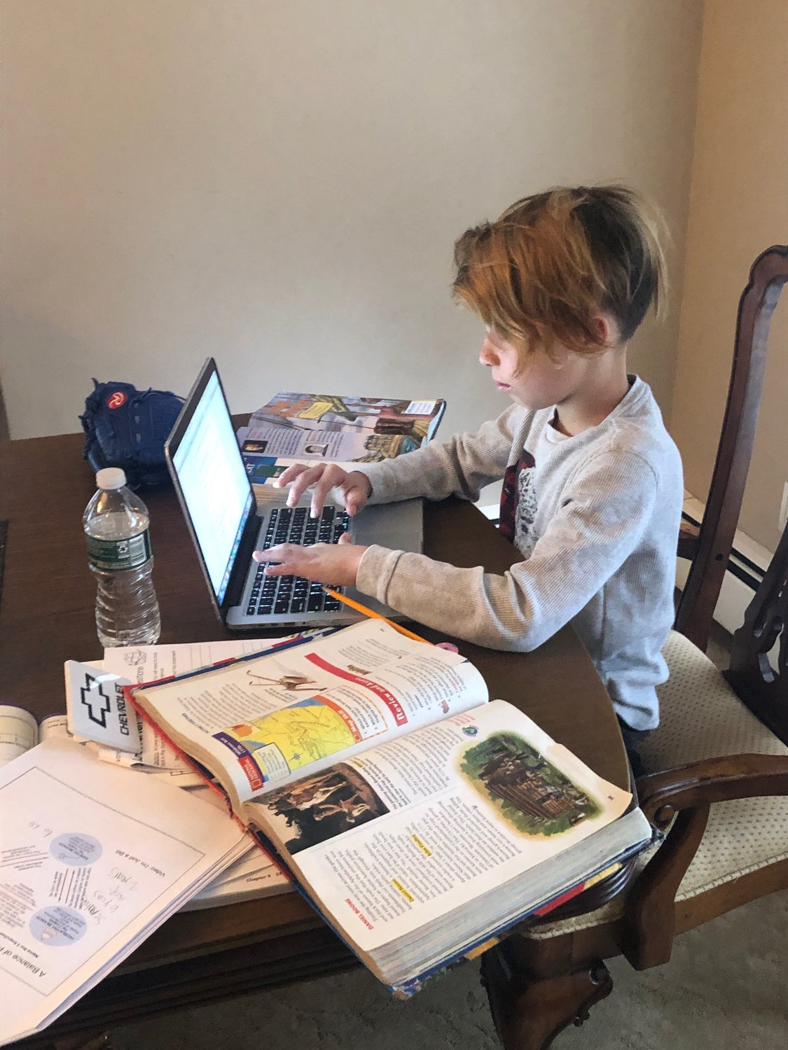 Christine Pagan's son, Joaquin, a student Brooklyn Avenue Elementary School, created his own schedule to adapt to virtual learning.