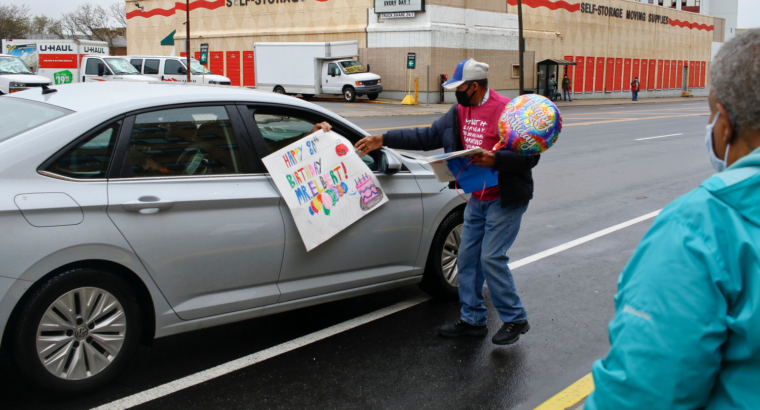 "Elbert ""Elmo"" Wilder, a custodian at the Friedberg JCC school in Lynbrook for more than 40 years, was honored with a surprise drive-by parade to celebrate his birthday on May 1. Drivers dropped off birthday signs, balloons and even a cake."