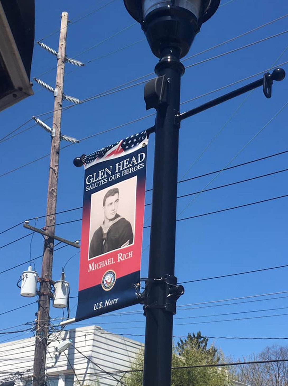 Veteran Michael Rich's Hometown Heroes banner was the first to be hung up in Glen Head.