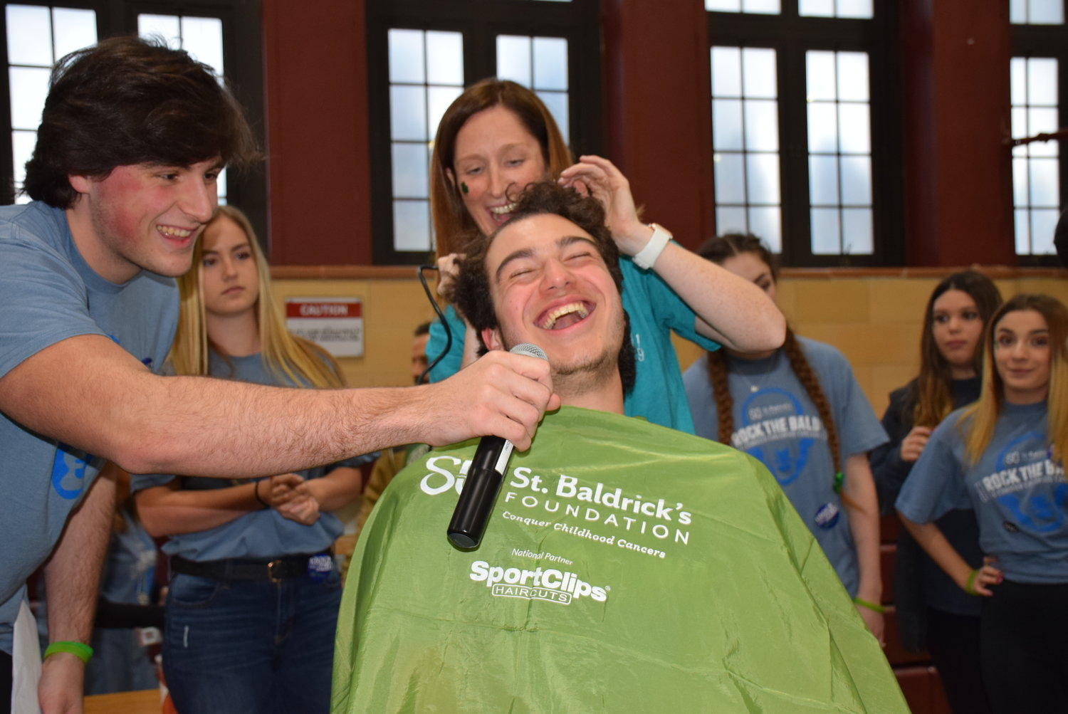Emcee Connor Molloy interviewed Mepham sophomore Jack Savalli before social studies teacher and St. Baldrick's coordinator Kerry Dennis shaved his head at last year's event.