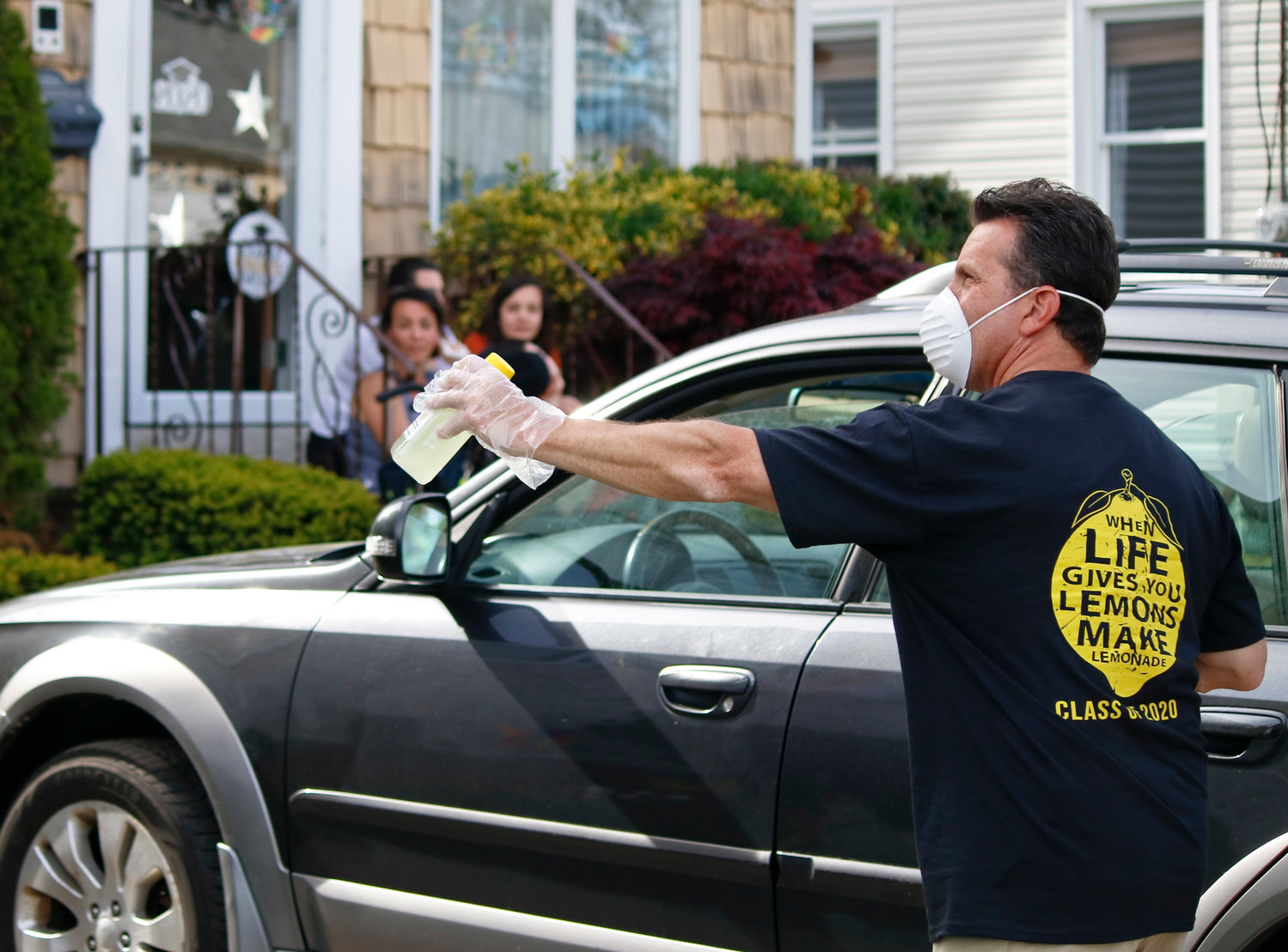 Carey High School Principal Christopher Fiore distributed lemonade to seniors and local residents along the parade route.