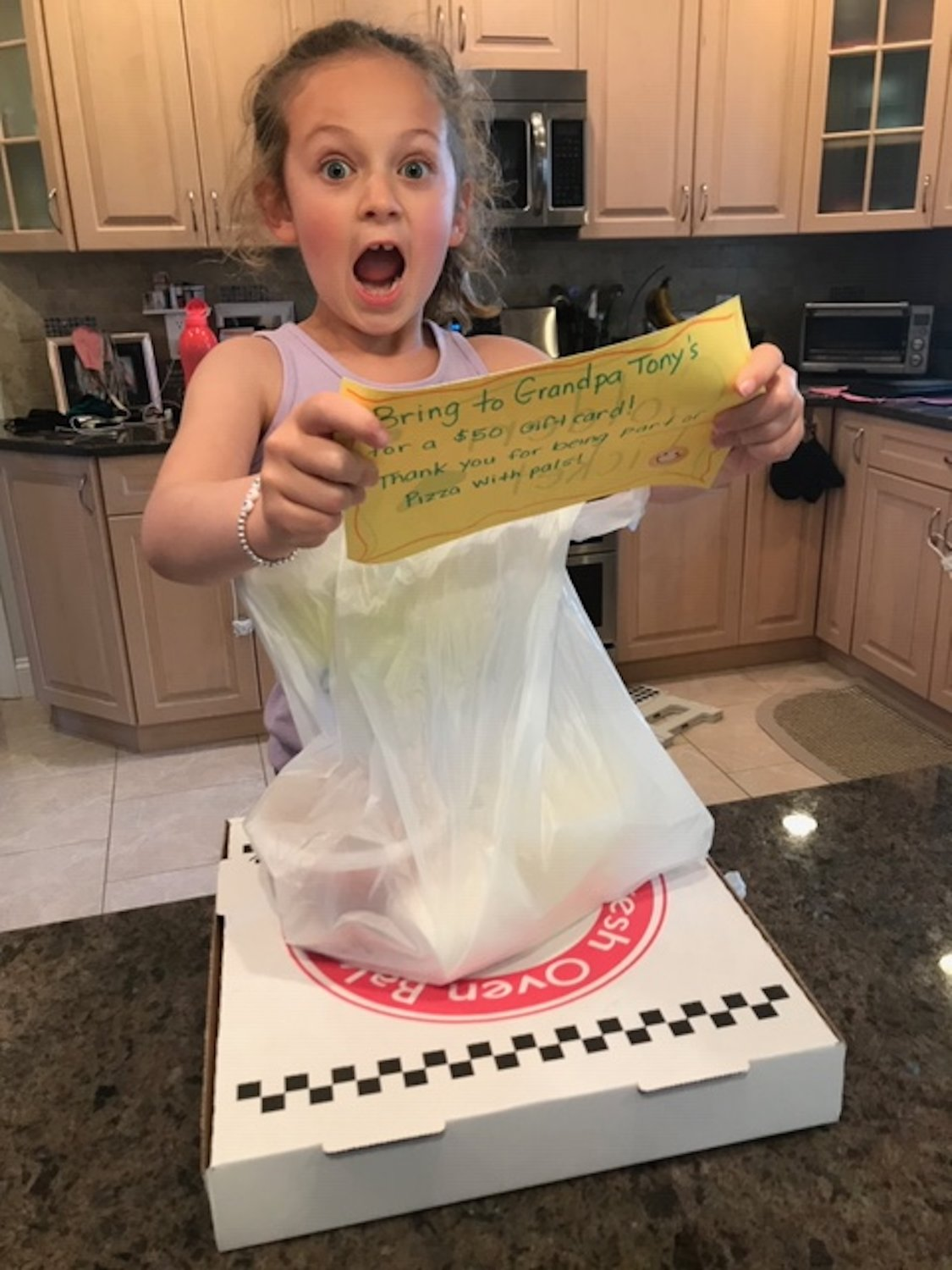 "Mackenzie McCabe earned a ""golden ticket"" for a $50 gift card to Grandpa Tony's, which hosted a virtual pizza party on May 15."