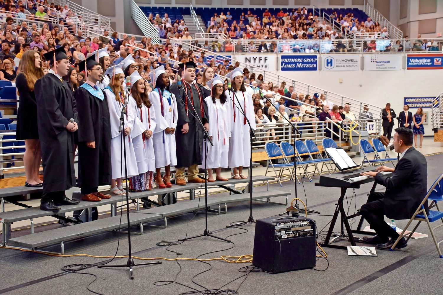The senior chorus sang at the H. Frank Carey graduation ceremony last year.
