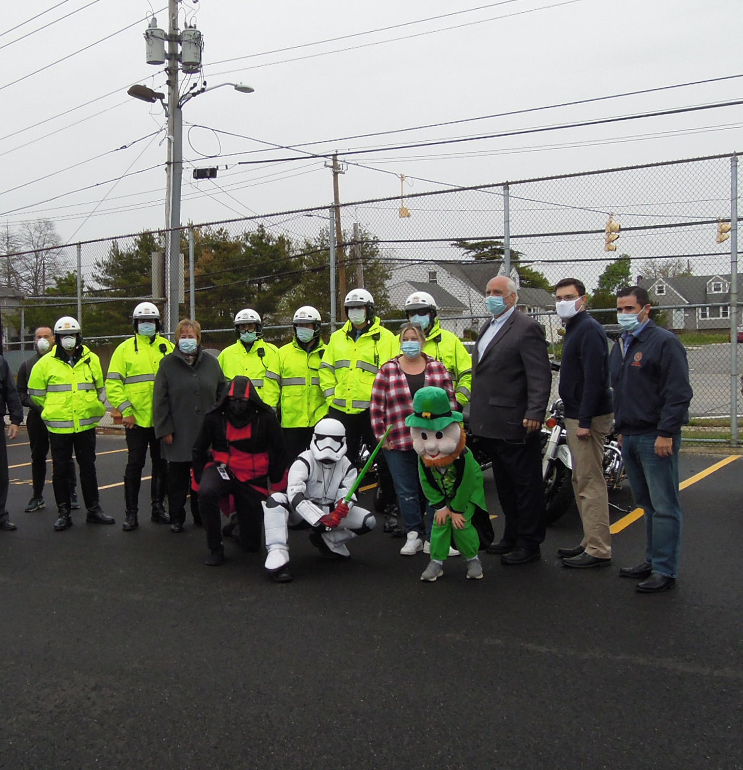 County Legislator John Ferretti, far right, State Assemblyman John Mikulin, Hempstead Town Councilman Dennis Dunne and Town Clerk Kate Murray, second from left, with police escort and film characters, helped honor first responders and front-line workers with a car parade through Ferretti's 15th District last Friday.
