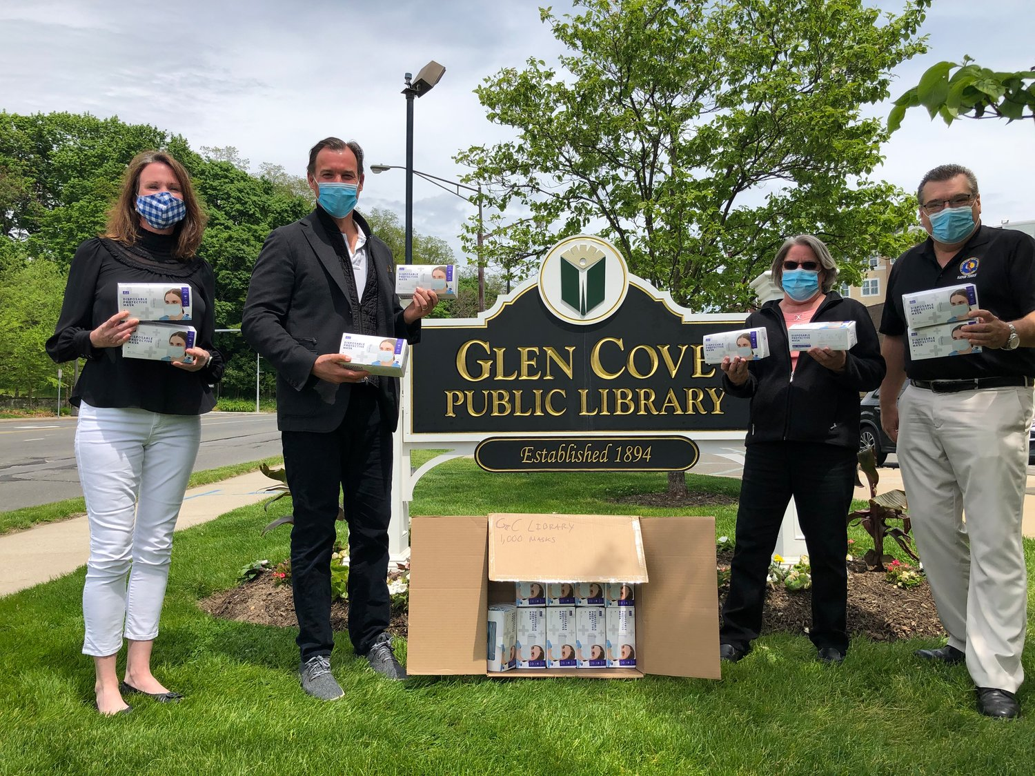 On Monday, U.D. Rep. Tom Suozzi, second from left, delivered personal protective equipment to the Glen Cove Senior Center, where he spoke with Christine Rice, the center's director, far left, Kathie Flynn, the director of the Glen Cove Library, and Mayor Tim Tenke.