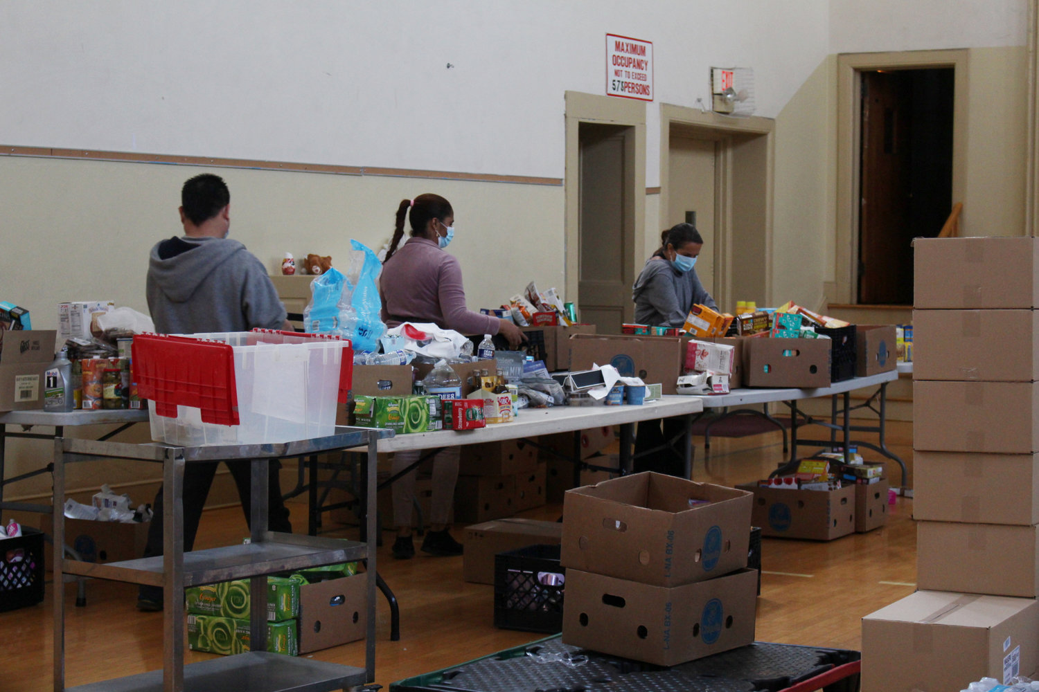 Boxes of food were stored in the parish gymnasium.