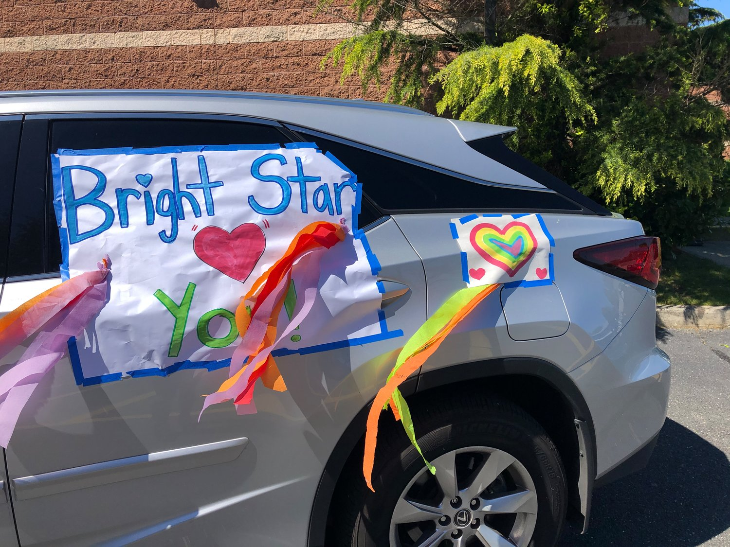 Teachers decorated their cars for a socially distant visit with students.