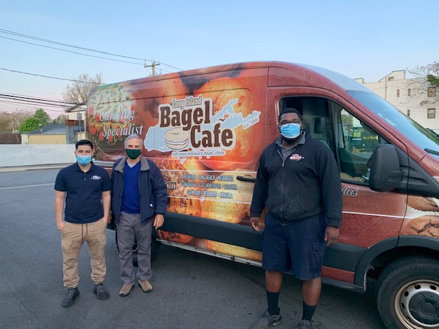 Jose Sandovar, a Bagel Cafe chef, left, Baldwin Civic Association Vice President Steve Greenfield and Bagel Cafe managing partner Julius Jones delivered the food at around 5 a.m. last Thursday.