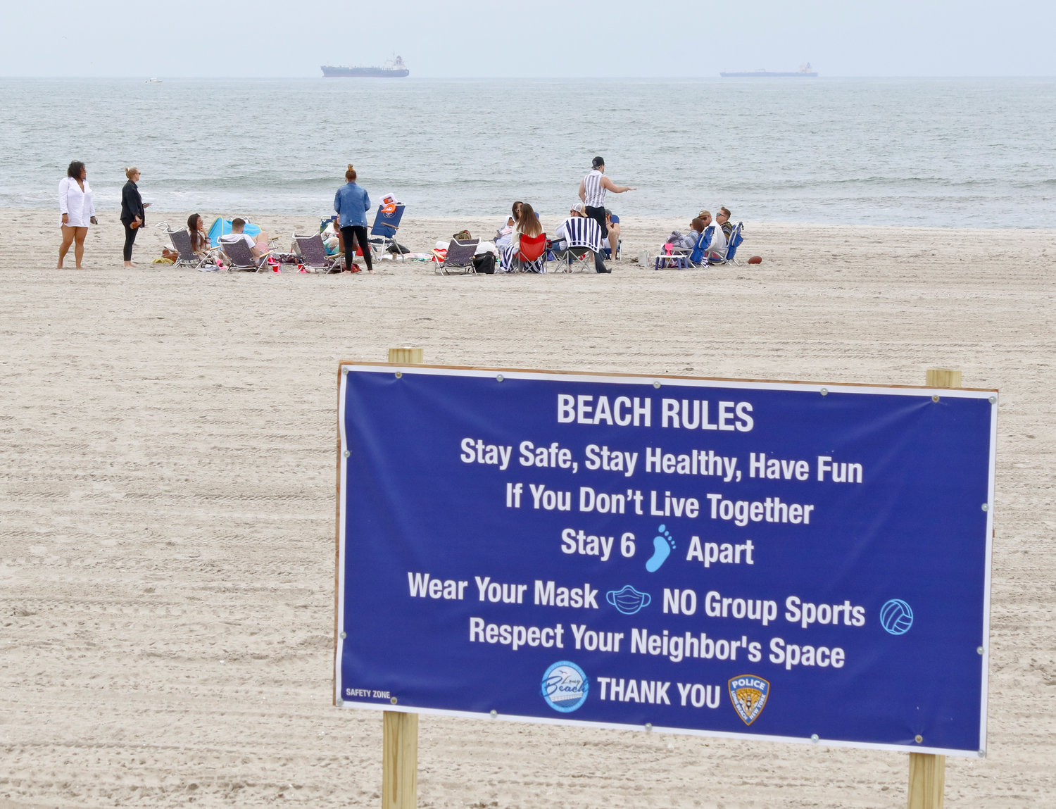 Some Long Beach residents went to the beach this weekend as social distancing signs were on display.