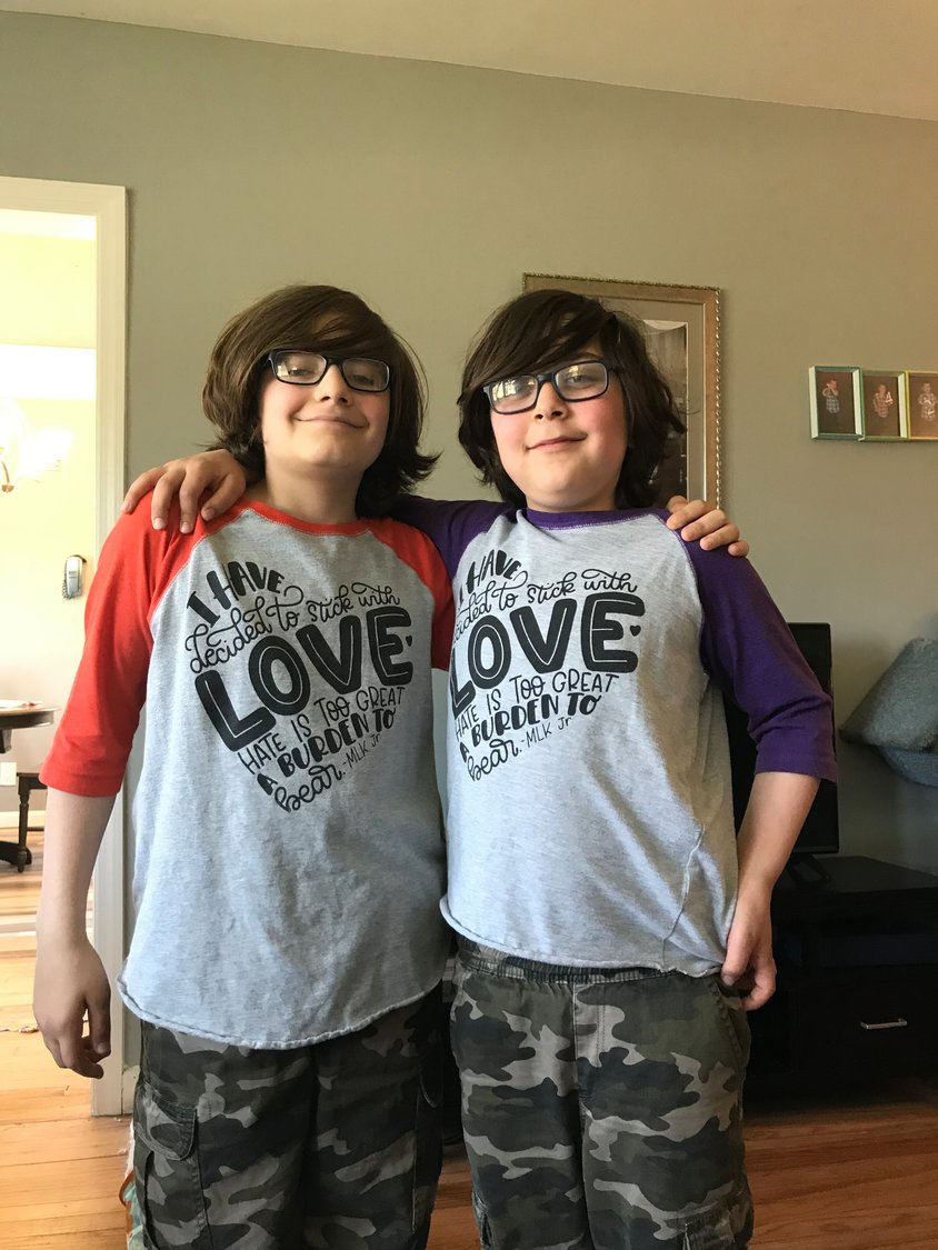 Brothers Elias, left, and Asher Katz, from Martin Elementary, wore their Dr. Martin Luther King quote shirts to spread positivity.