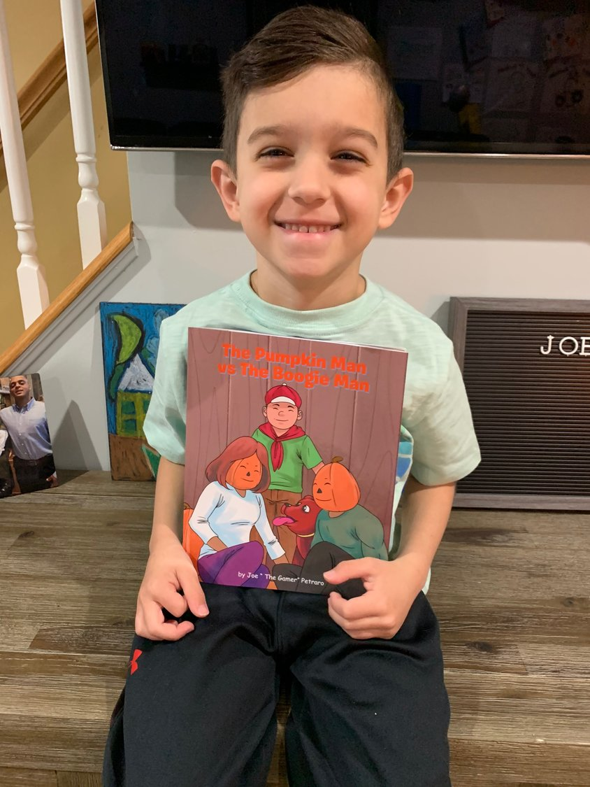 "Rhame Avenue Elementary School student, Joseph Petraro, 7, released his book, ""The Pumpkin Man vs. The Boogie Man"" on March 27."