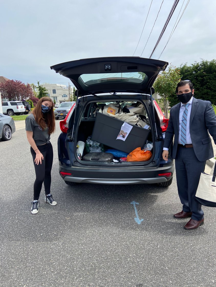 Sixteen-year-old Gabbie Goldberg, of Merrick, recently donated hand-packed care packages to health care workers at Mishkon, a group home for individuals with intellectual and developmental disabilities. She dropped off the donations to Mishkon's Assistant Director of Residnetial Services Israel Levy, right.