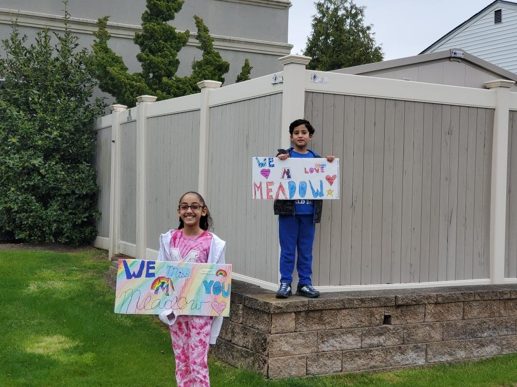 Students greeted their teachers with colorful homemade posters on May 8 when Meadow Elementary School teachers drove around Baldwin Harbor as part of a car parade to show student appreciation.
