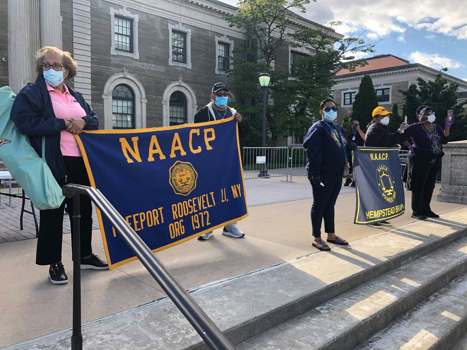 Freeporters Darleyne Mayers, left, and Eugene Williams, joined the protests in Nassau County as members of the Freeport Roosevelt NAACP.