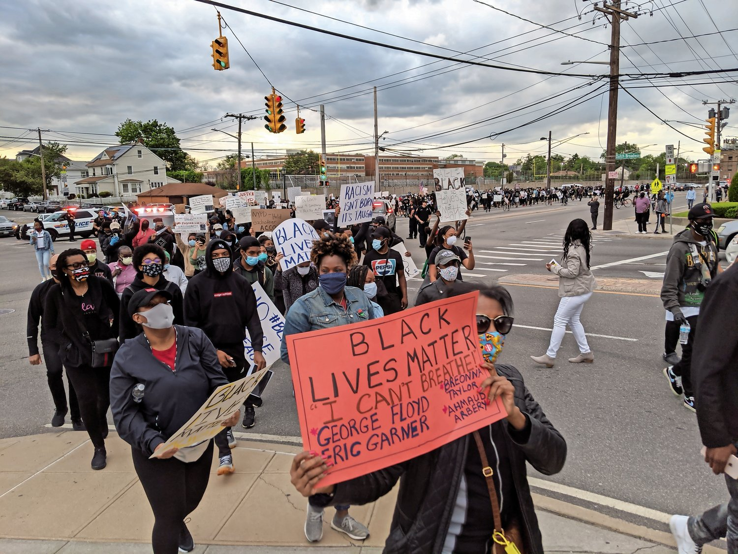 Nearly 200 Elmont and Valley Stream residents marched through the streets on Monday night to protest police violence, one week after a police officer killed George Floyd in Minneapolis.