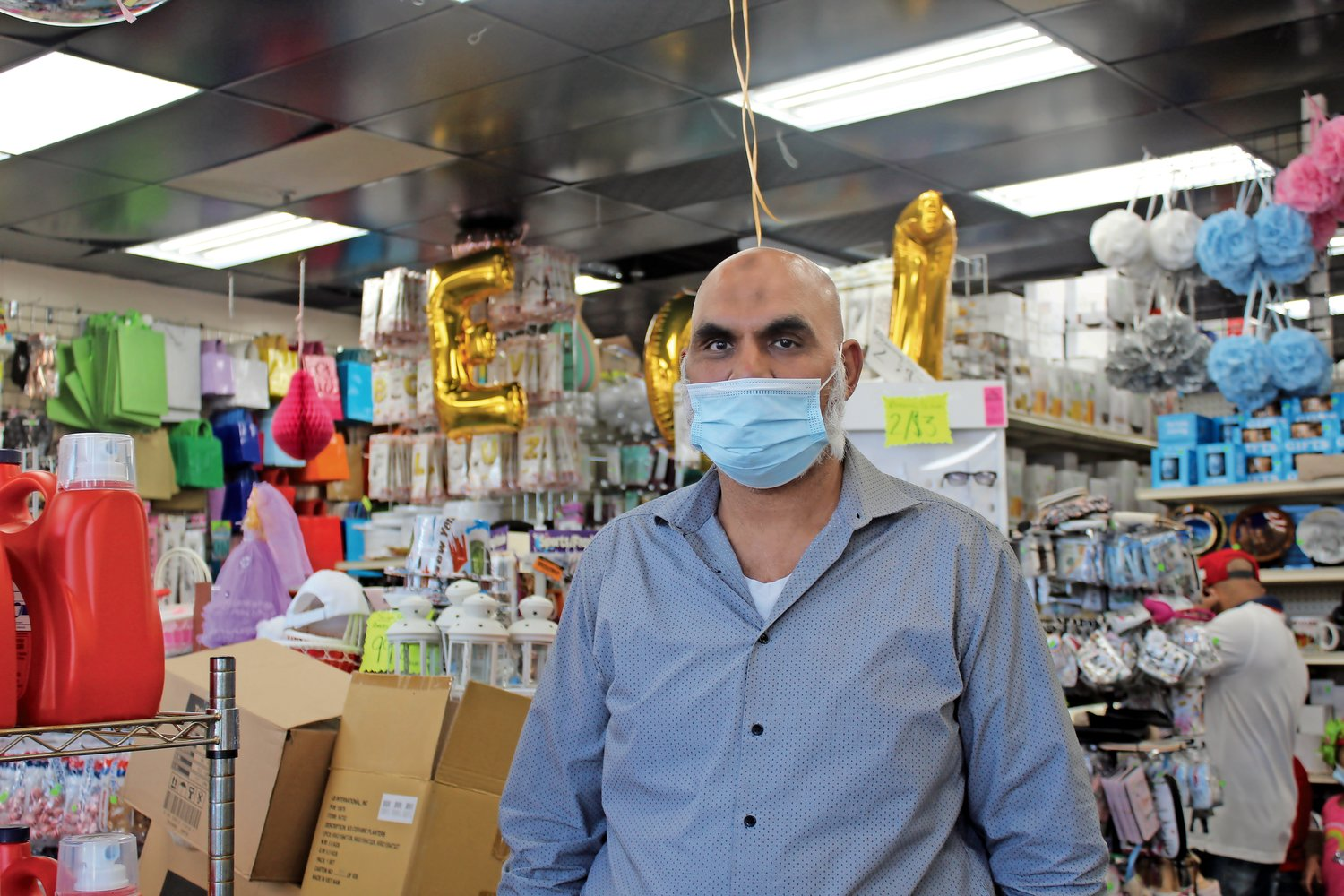 Mohammed Refran, owner of the Real Discount Outlet in Elmont, said it has been difficult to tell people to maintain social-distancing guidelines and wear masks.