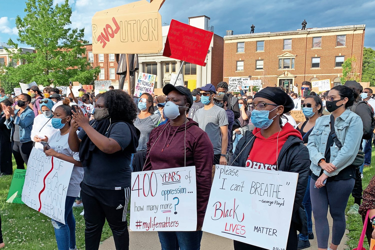 Dozens of people gathered at the Theodore Roosevelt Executive and Legislative Building on Monday to protest the killing of George Floyd by a Minneapolis police officer on Memorial Day.