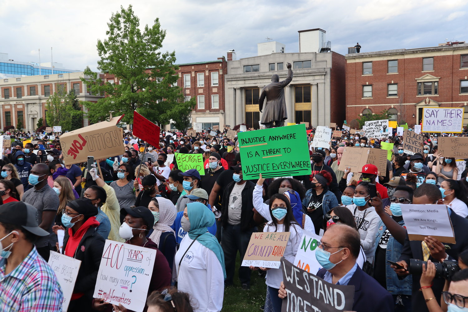 Nearly 1,000 protesters occupied the front lawn of the Nassau County Legislature and Executive Building on Monday.