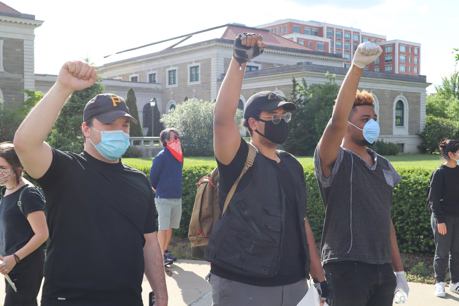 Michael Fernandez, Tyler Belo and James Merchant raised their fists in solidarity.
