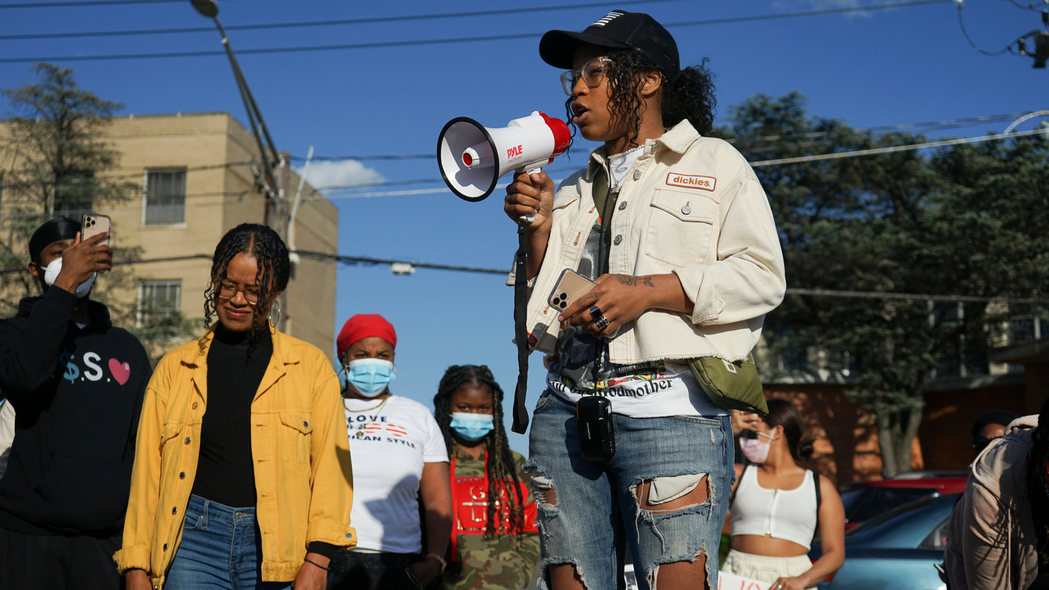 Valley Streamer Christine Rivera, left, and Elmont resident Goldie Harrison, center, organized Monday's protest.