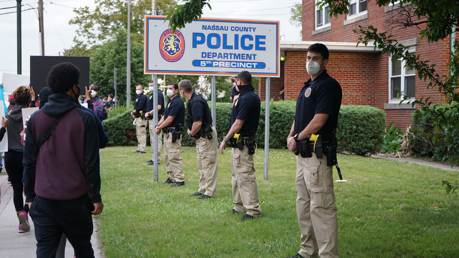 Nassau County officers stood guard as the protest passed the 5th Precinct.