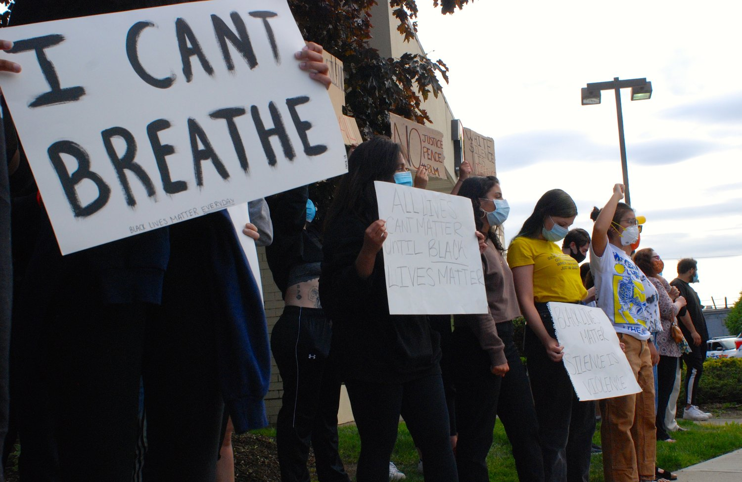"Many protesters wrote ""I can't breathe"" on their signs. George Floyd died after a Minneapolis police officer pressed his knee into his neck for more than eight minutes. Floyd had pleaded with the officer, telling him that he could not breathe."