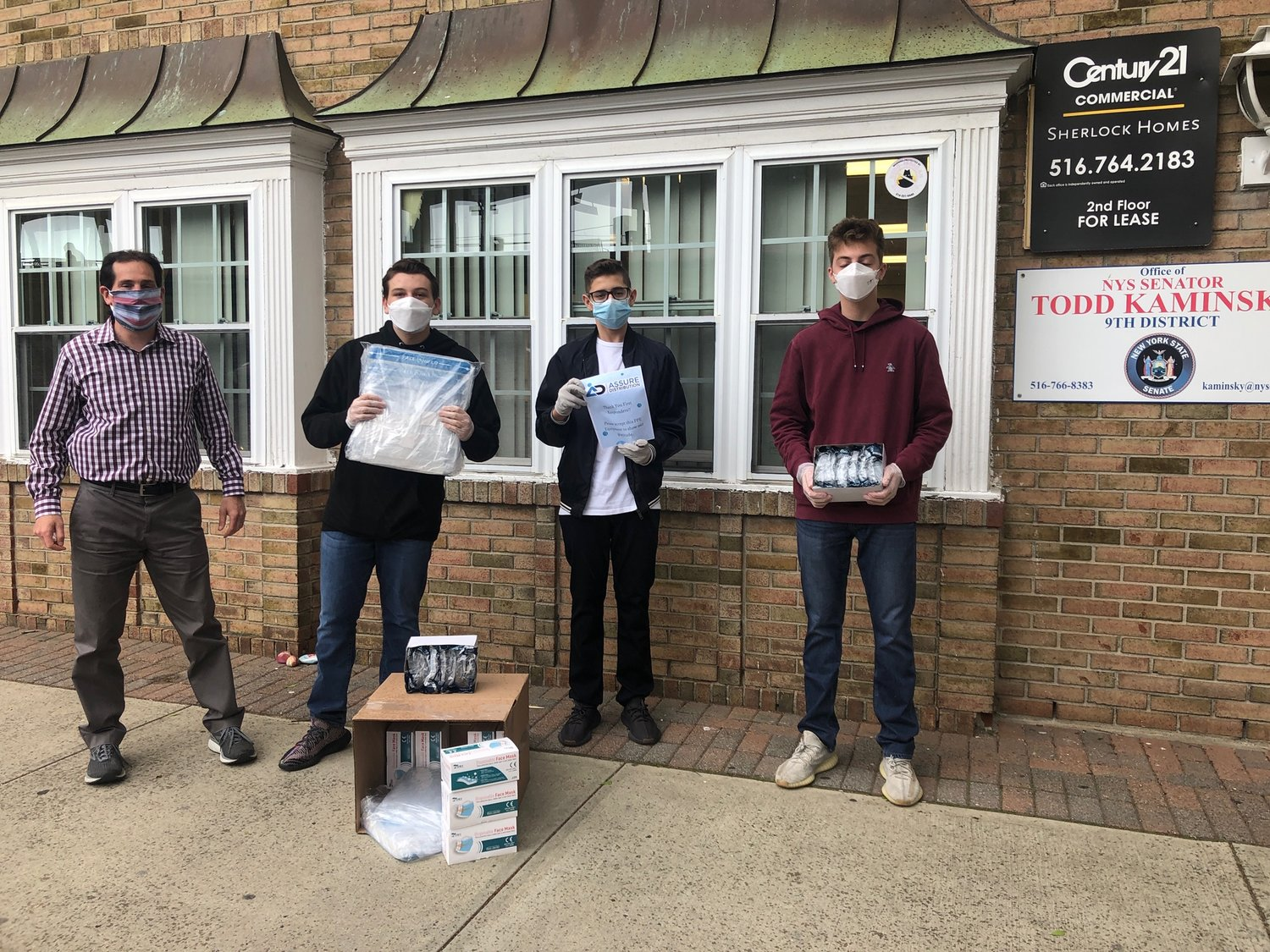 MID Donations has worked with State Sen. Todd Kaminsky, left, who was with Dylan Mirvis, Matthew Field and Ian Volman outside the state senator's Rockville Centre office on May 11.