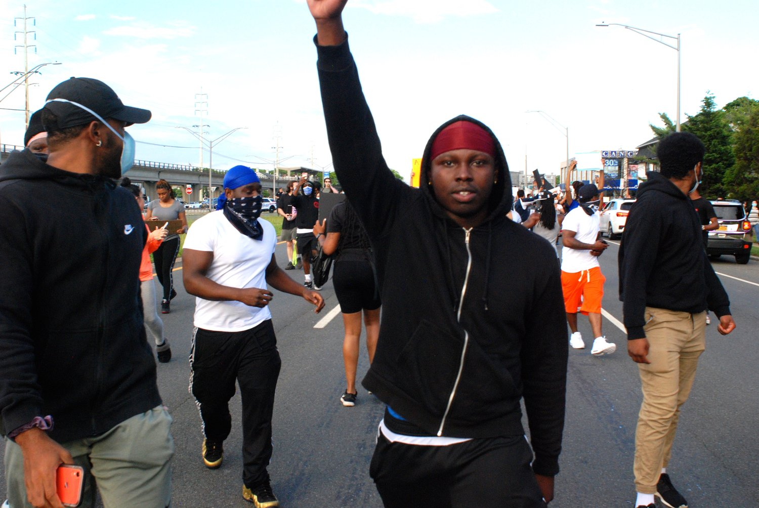 Many demonstrators marched with their arms held high.