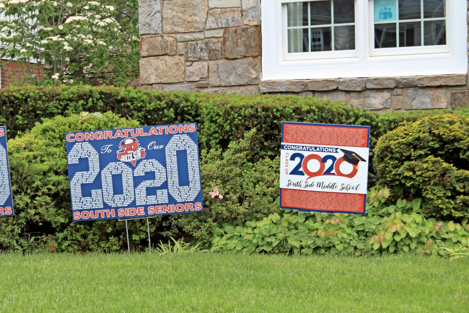 Signs honor those moving up from South Side Middle School and graduating from South Side High School this spring.