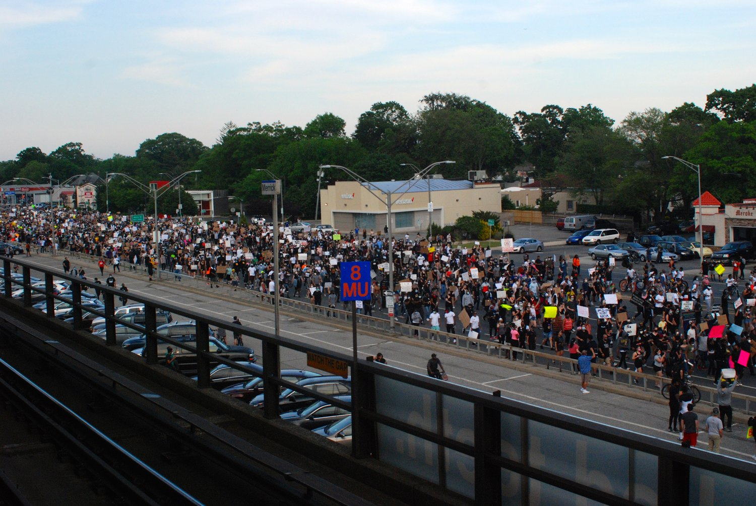 Nassau County police estimated the crowd at 4,000 people. Above, protesters on Sunrise Highway arriving at the Merrick Long Island Rail Road station.