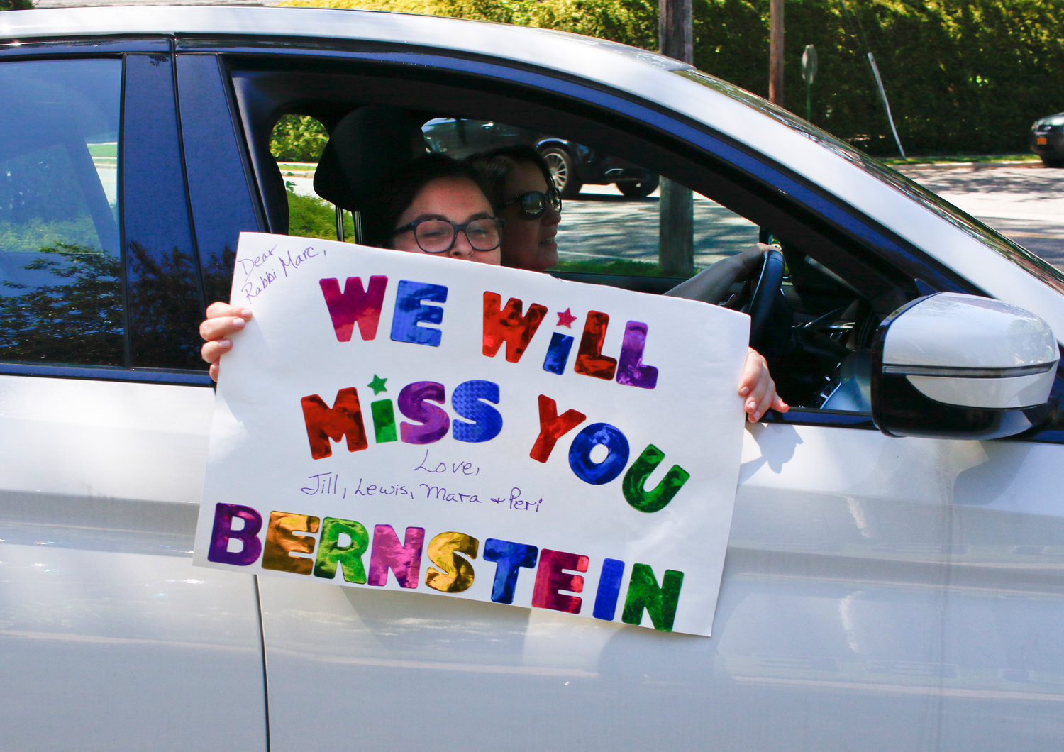 The Bernstein family made a special sign for Rabbi Marc Gruber