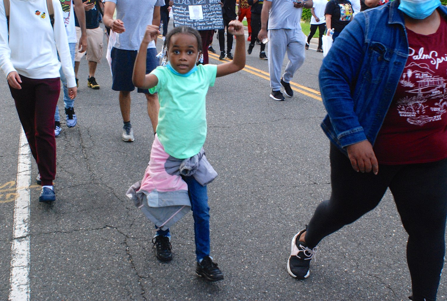 "Wynta-Amor Rogers, 7, marching during the Black Lives Matter protest in Merrick on Wednesday. The Herald's video of her chanting, ""No justice, no peace!"" had more than 20 million views on Twitter as of Friday."