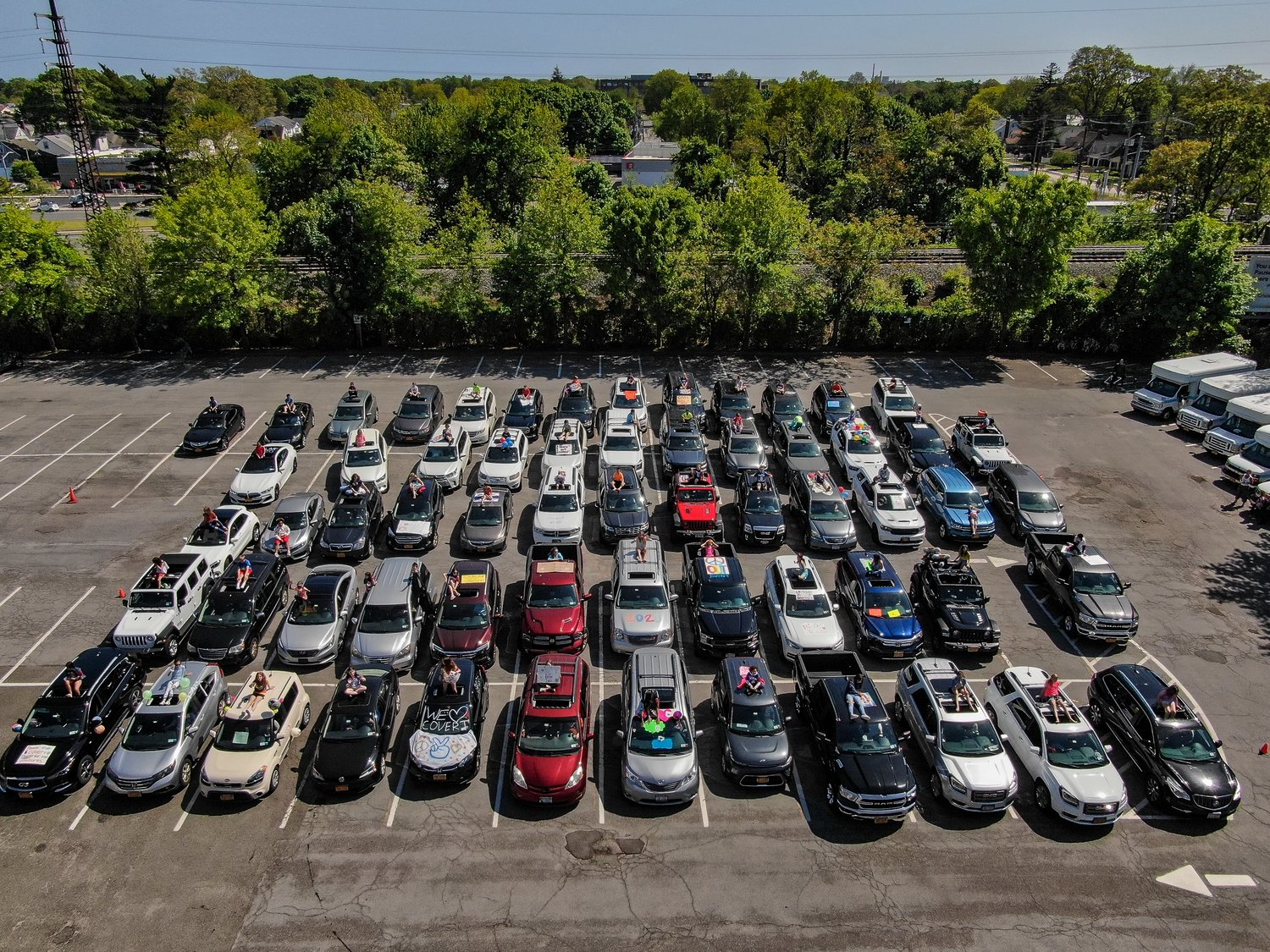 The 63 Covert Elementary School fifth graders took a socially-distant drone graduation photo in the parking lot of the Rockville Centre Recreation Center.