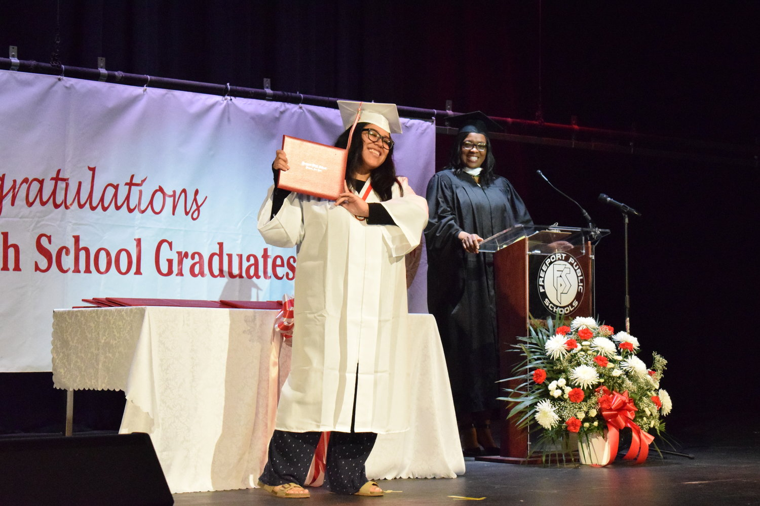 Dayley DeLeon Estevez showed off her diploma at a series of ceremonies at the Freeport High School set to honor the Class of 2020.