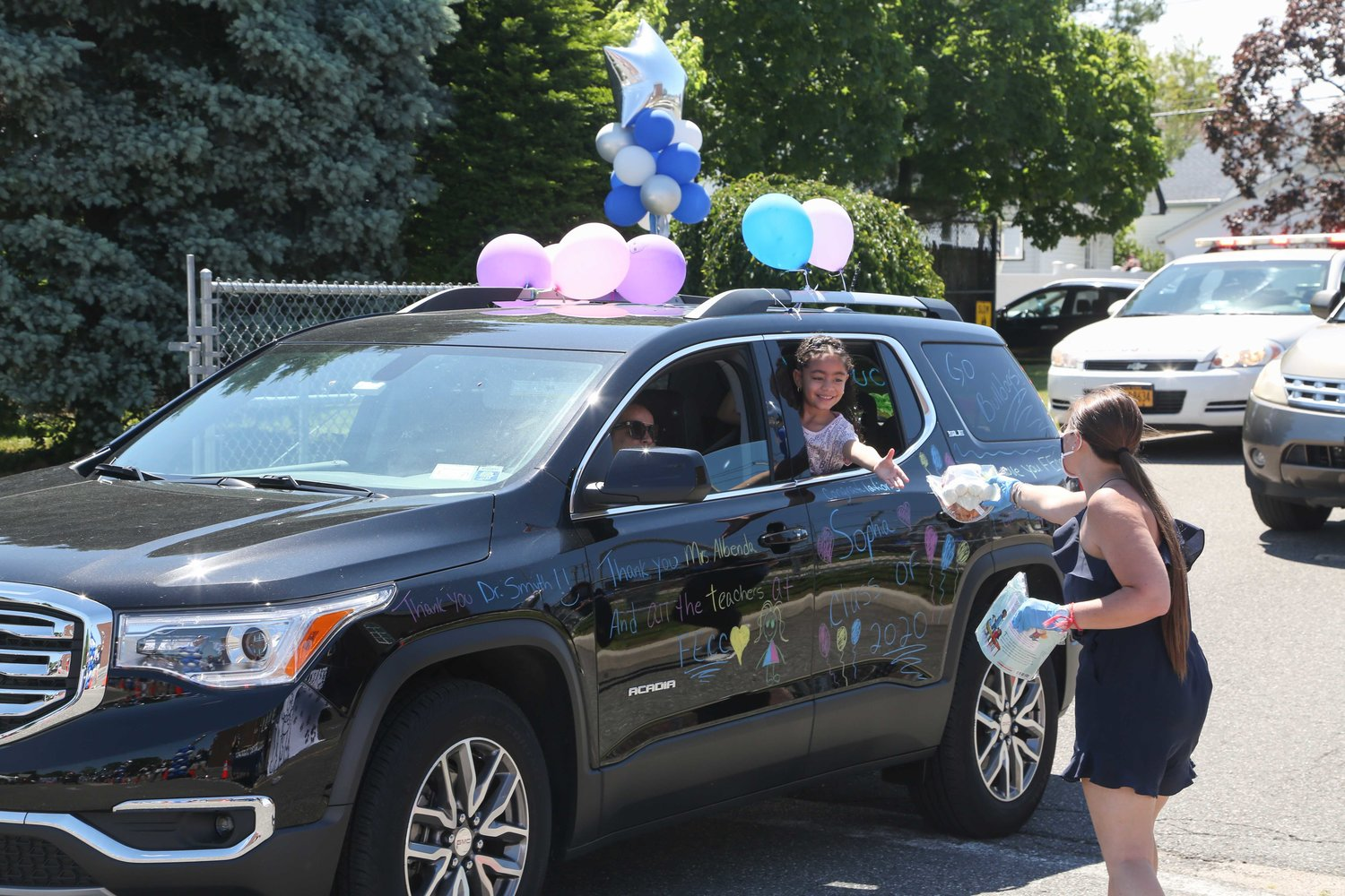 Second-grader to be Sophia received her parting gift at the car parade.