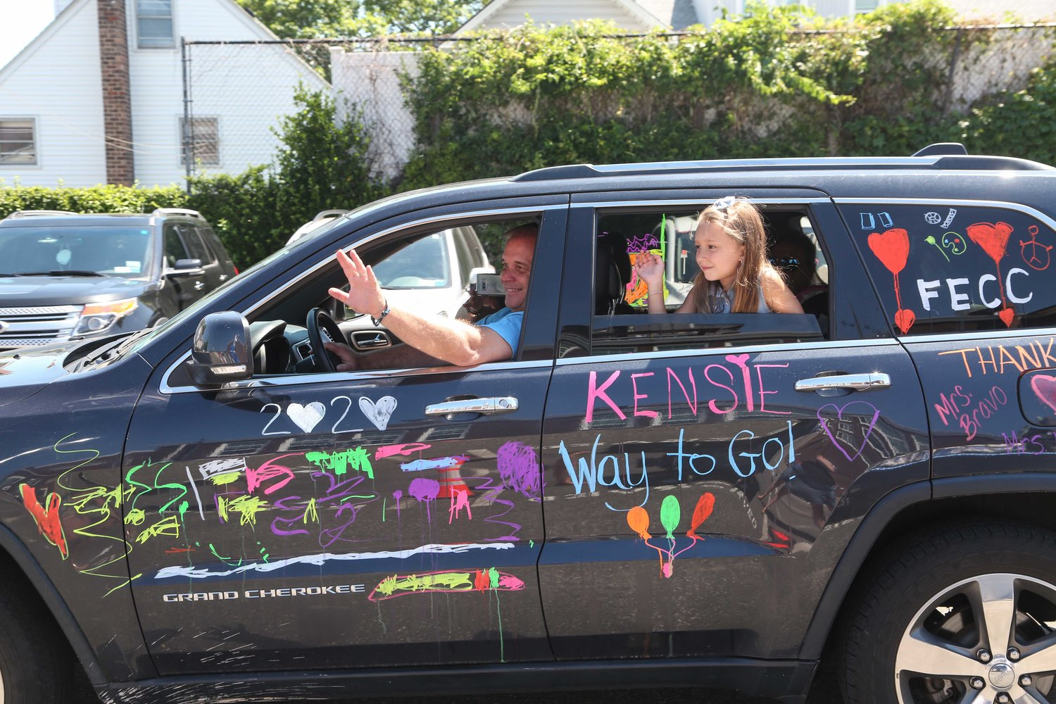 Kensie and her father waved to the FECC faculty as they drive through.