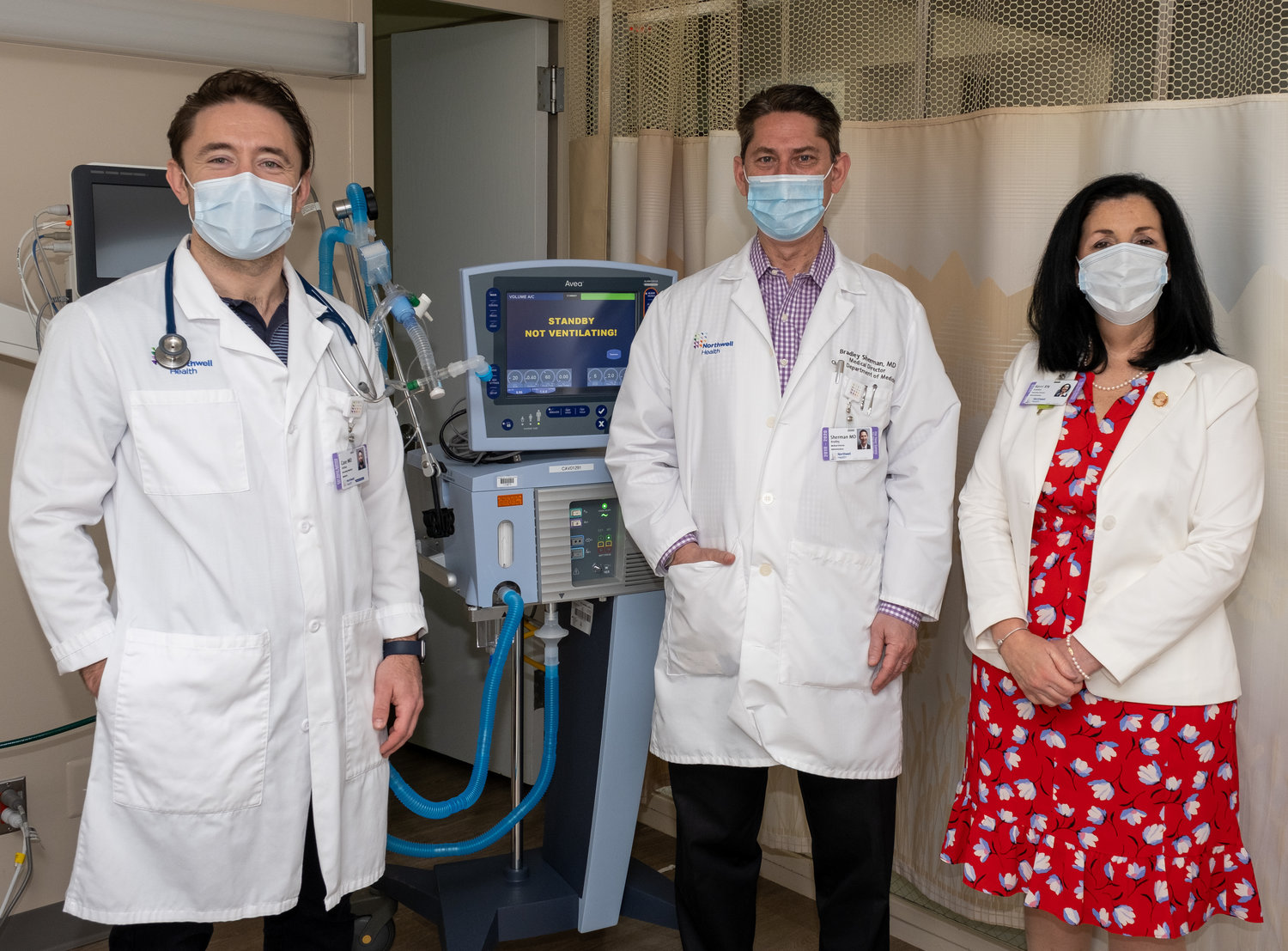 Dr. Josh Case, far left, Dr. Brad Sherman and Glen Cove Hospital's executive director, Kerri Scanlon, in the hospital's new Acute Ventilator Recovery Unit, the first of its kind in the country, which provides short-term care for patients who have been on ventilators, including those recovering from Covid-19.
