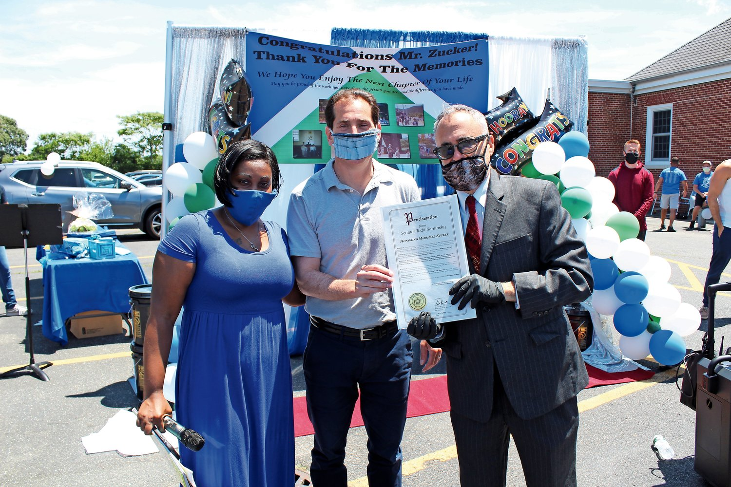 Gotham Avenue Principal Marshall Zucker, right, received a proclamation in honor of his retirement from State Sen. Todd Kaminsky on June 16. They were with Parent Teacher Association President Natasha Appleby.
