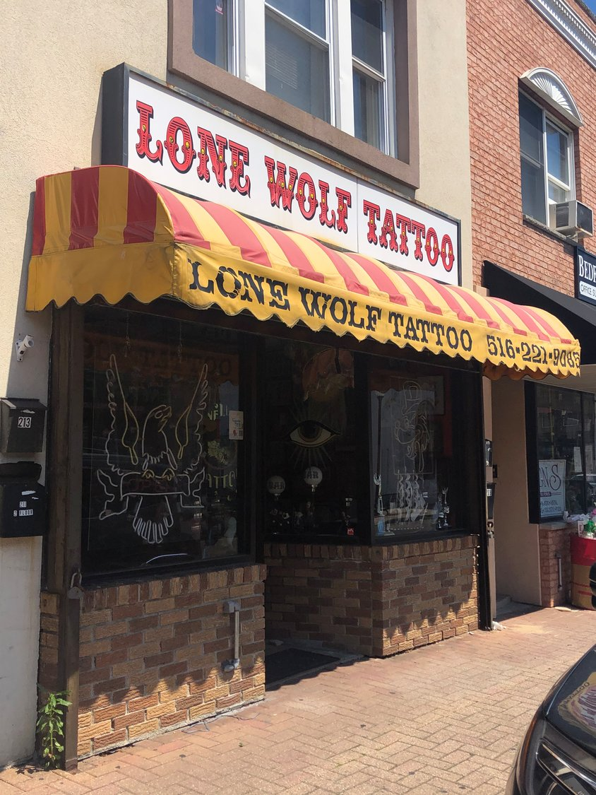 Lone Wolf Tattoo will squeeze in new customers while rescheduling those as far back as mid-March.