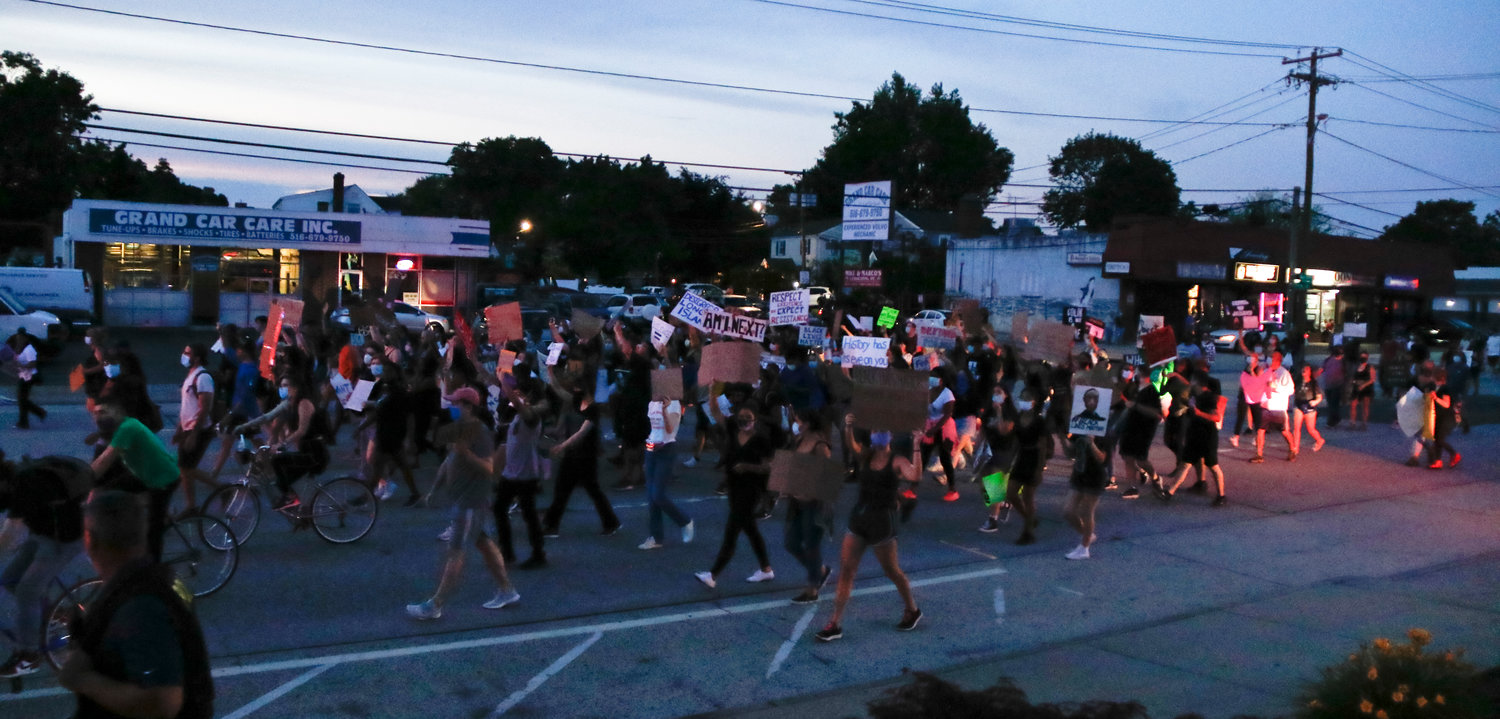 Marchers and accompanying police arrived at Cedar Creek Park at 8:30 last Friday at the end of a six-mile trek from Amityville.