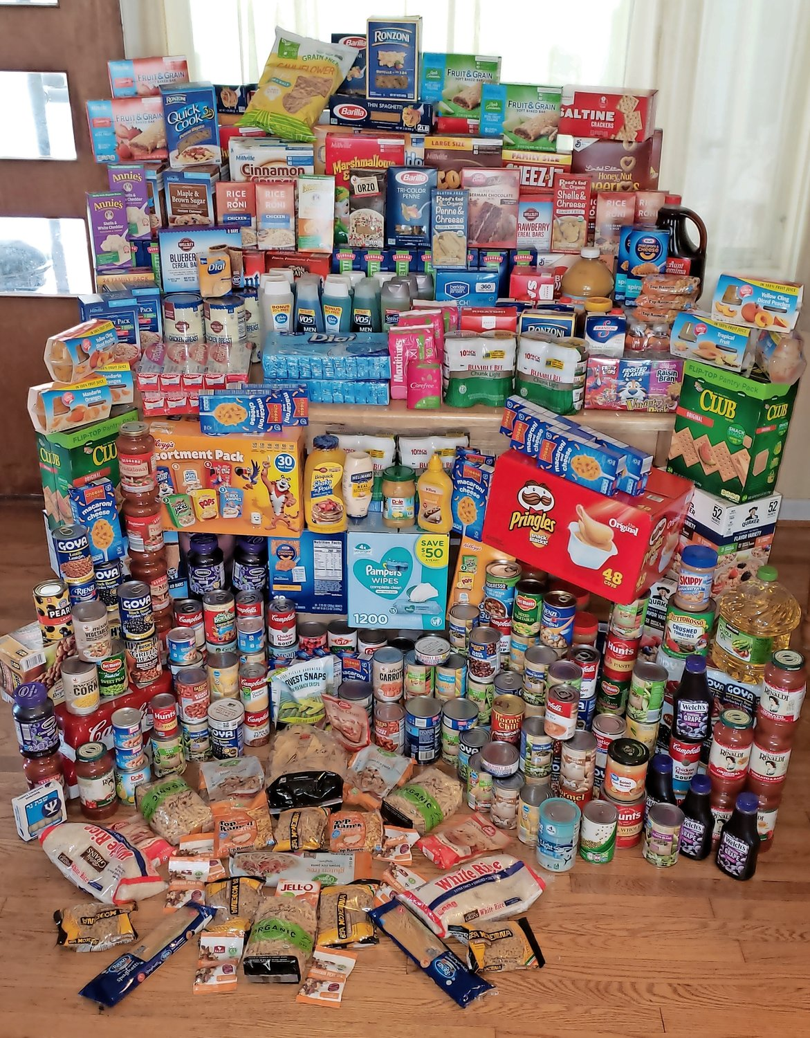 Assistant Scoutmaster Mary Canzoneri said she received more than 100 nonperishable food items at her home for the food drive.
