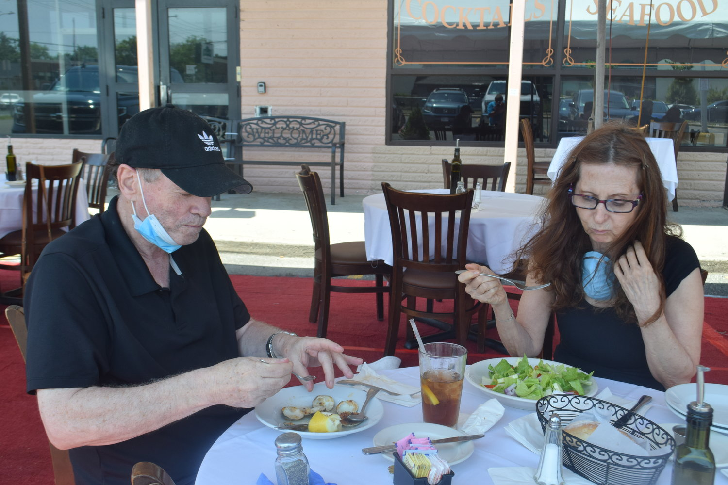At Friendlier Italian Restaurant in Woodmere, Bayside residents Neal and Ilene Rose dug into their lunch appetizers.