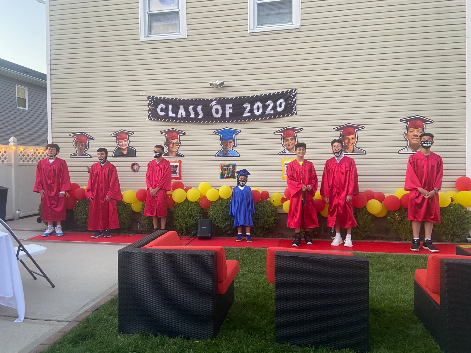 A group of parents hosted a backyard graduation ceremony to give their children the experience they missed due to the coronavirus.