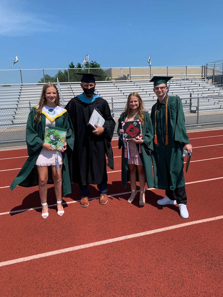 Triplets Frankie, Georgie and Luke Yandolino posed with Kennedy Principal Gerard Owenburg after they received their diplomas.