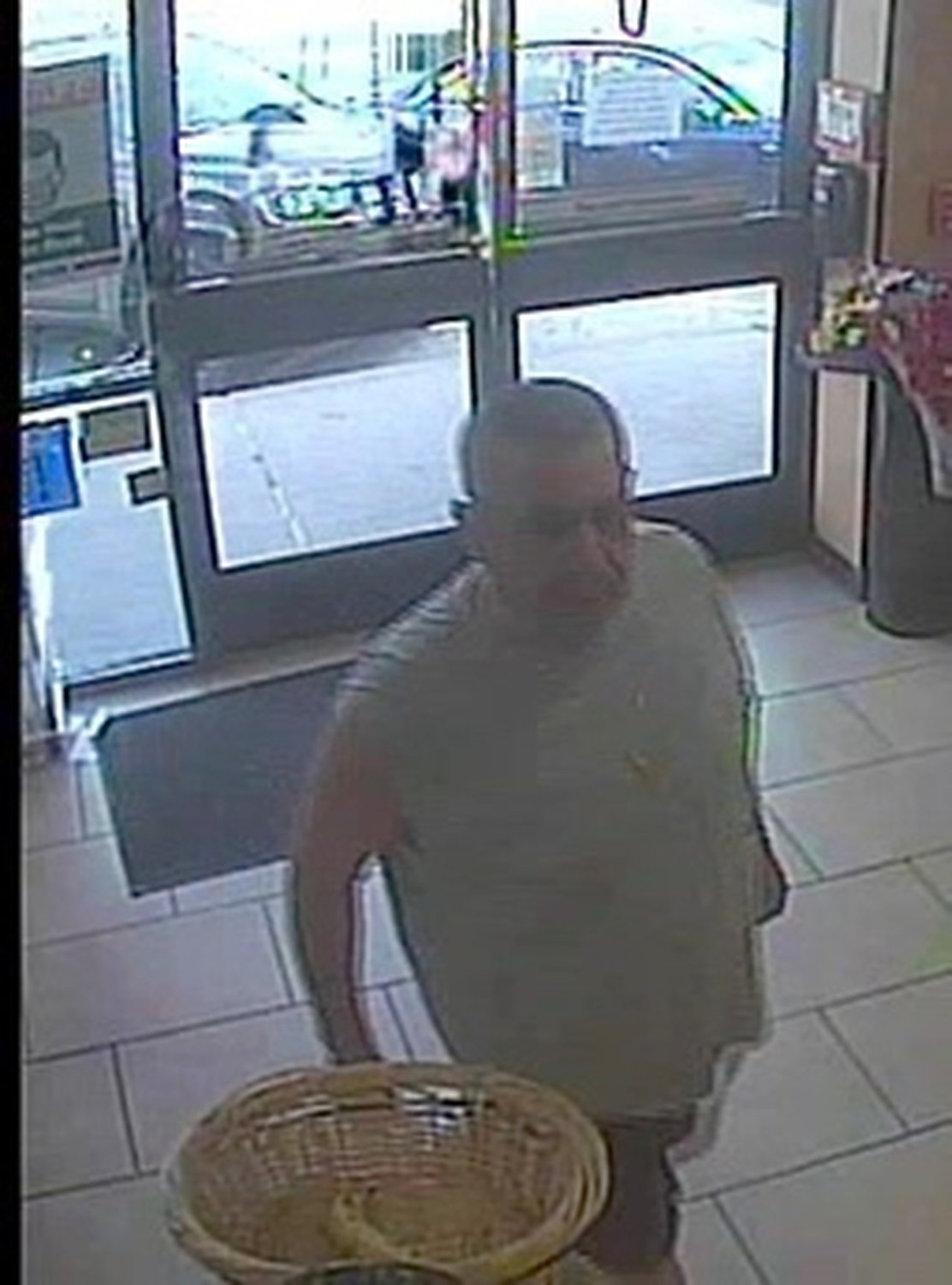 The man that allegedly robbed the 7-Eleven on Mill Road in Hewlett is described by police as white and in his 50s.