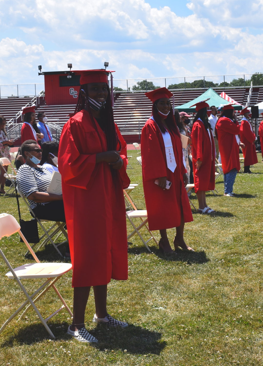 Two Glen Cove seniors were ready to receive their diplomas.