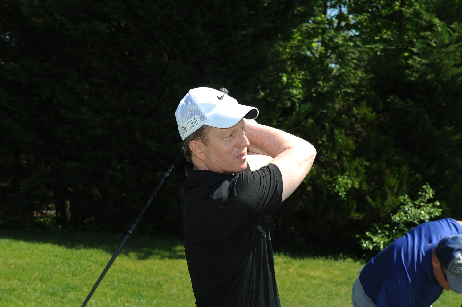 Mount Sinai South Nassau hospital has postponed its annual golf outing to Sept. 14. In 2018, board member Lowell Frey followed the flight of his shot at the event.