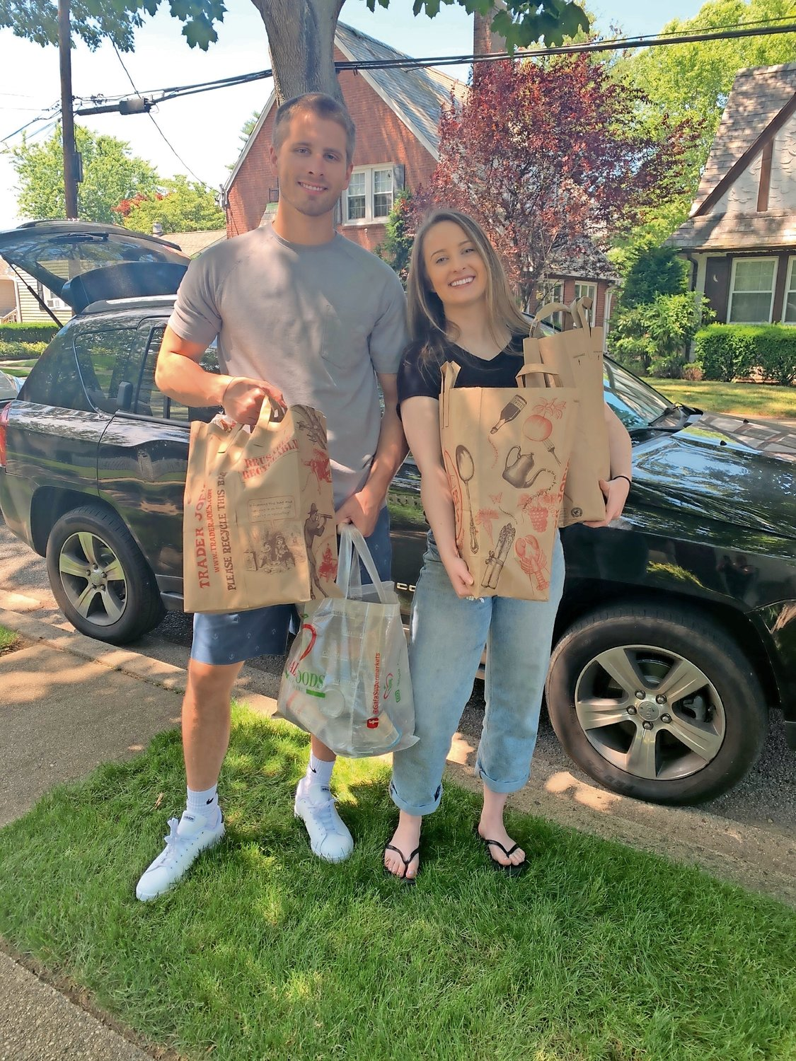 Michael Miskiewicz helped his sister, Molly, unpack donations from her car on June 26.